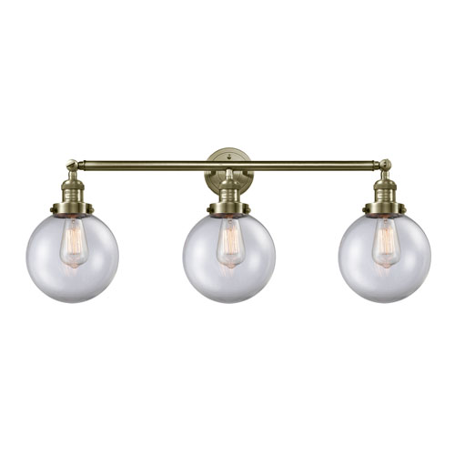 Innovations Lighting Beacon Antique Brass Three-Light LED Bath Vanity with Eight-Inch Clear Globe Glass