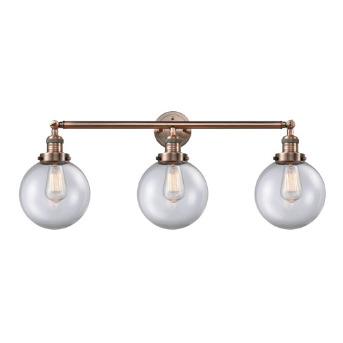 Innovations Lighting Beacon Antique Copper Three-Light LED Bath Vanity with Eight-Inch Clear Globe Glass