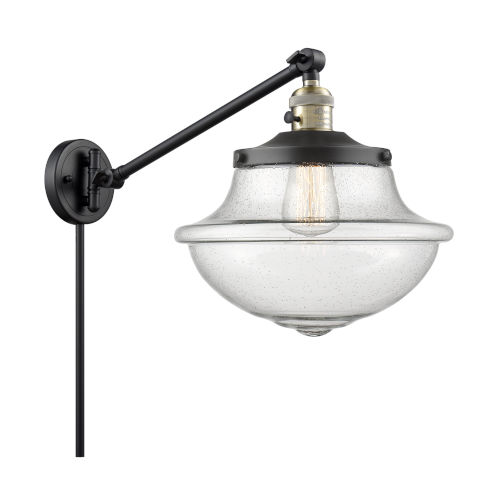 Franklin Restoration Matte Black Antique Brass 12-Inch One-Light Swing Arm Wall Sconce with Seedy Glass Shade