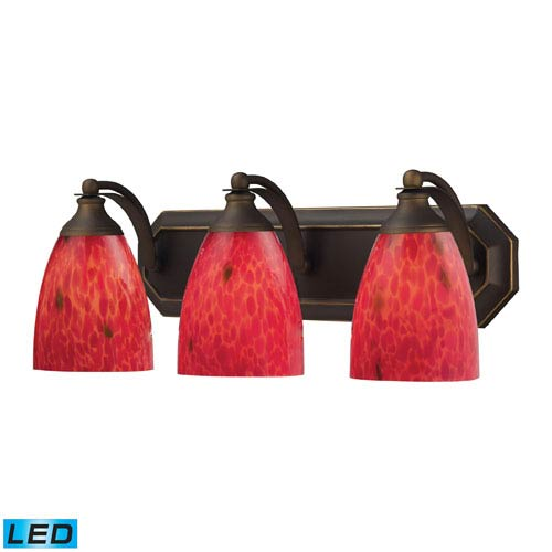 Elk Lighting Vanity Three Light LED Bath Fixture In Aged Bronze And Fire Red Glass