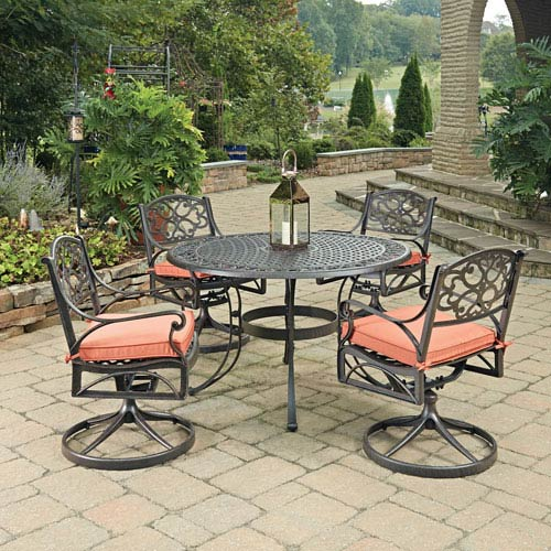 Home Styles Furniture Biscayne Rust Bronze Round 5 Piece Outdoor Dining Table and 4 Swivel Rocking Chairs with Cushions