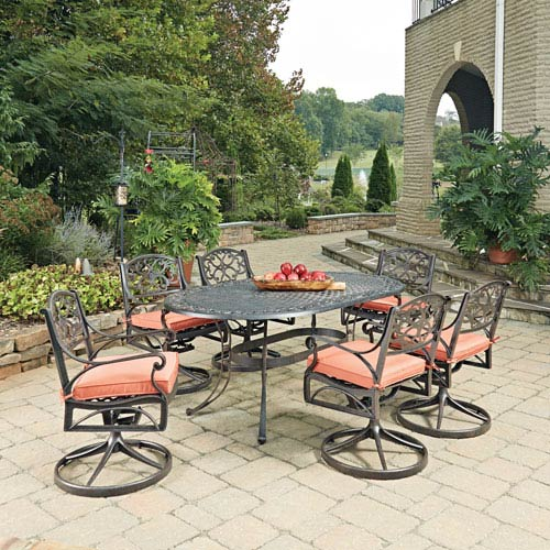 Home Styles Furniture Biscayne Rust Bronze Oval 7 Piece Outdoor Dining Table and 6 Swivel Rocking Chairs with Cushions
