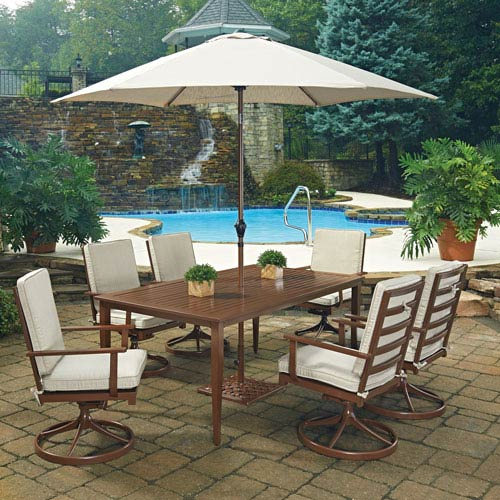 Home Styles Furniture Key West 9 Piece Rectangular Outdoor Dining Table; 6 Swivel Rocking Chairs with Umbrella and Base