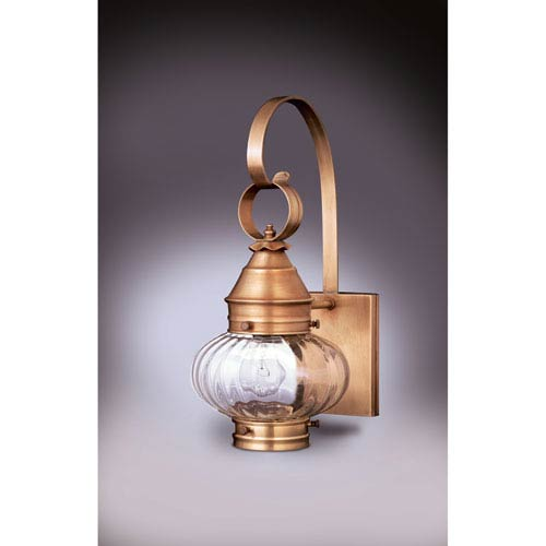Onion Antique Brass One-Light Seven-Inch Outdoor Wall Mount with Optic Glass