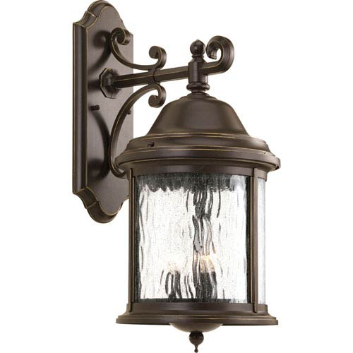 Ashmore Antique Bronze 20.5-Inch Three-Light Outdoor Wall Mount with Water Seeded Glass Curved Panels
